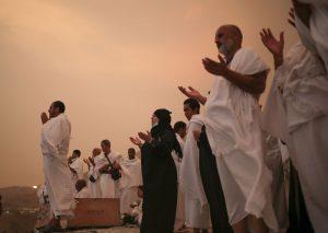 Pilgrims making Dua on Jabal al-Rahma in Arafat