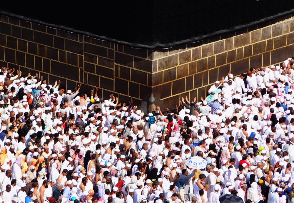 Pilgrims clinging on to the walls of the Kaaba