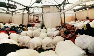 Pilgrims praying Salah in a tent